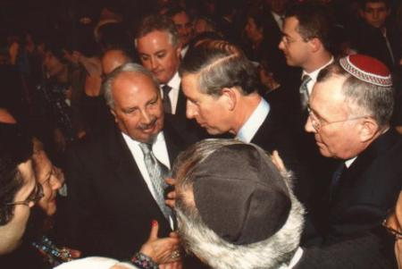 Renée and Naim Dangoor in conversation with Prince Charles in 2001 at the Bevis Marks synagogue.