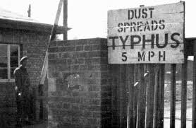 British Military sign warning of typhus outbreak at Belsen concentration camp shortly after liberation.