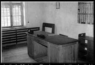 """Camp complaints office where inmates could register complaints or make suggestions. Camp Commander Hoess had a standing order that any inmate could approach him personally to register a complaint about other inmates such as """"Kapos"""" and even guards.* A system of strict discipline for guards and also for inmates, with severe punishment being handed out against those found guilty (for even slapping an inmate)"""