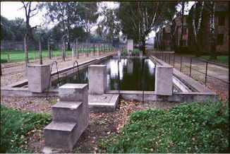 A camp swimming pool for use by the inmates, where there were walkways with comfortable benches for inmates to relax in the shade of the trees. Swimming galas were held during the Summer months.