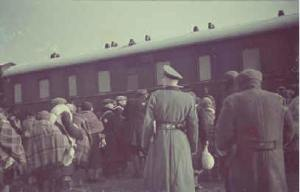 Genuine photograph of inmates leaving for Auschwitz - notice the train is a passenger train not the Hollywood cattle train version.