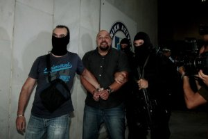 """Ilias Panayiotaros, when arrested by the masked servants of the Jewish occupational government, said """"Shame on them, the people will lift Golden Dawn higher."""""""