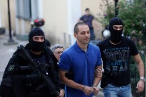 "Golden Dawn's Ilias Kasidiaris being hauled off by masked thugs.When he was grabbed, he shouted ""Nothing will bend us! Long live Greece!"""