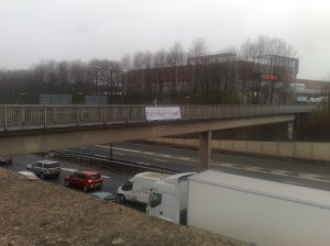 "Early morning BNP flash demo above M67 motorway in Tameside. The banner says ""British National Party Say : STOP PAEDOPHILE RINGS."""