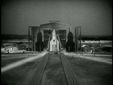 The grand opening of the massive hangar doors and the excruciatingly slow roll-out of the upright rocketship from the hangar to the launch pad are the same in the 1929 film and the Apollo Missions.