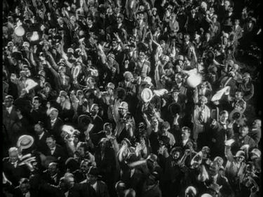 Cheering crowds during teh countdown in the 1929 film.